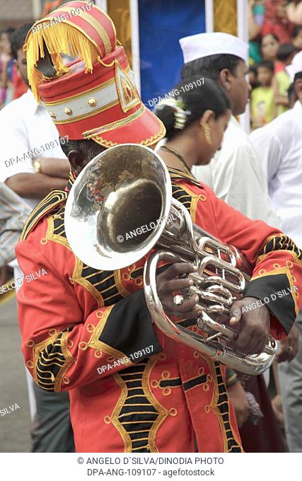 Musical Blowing instrument Euphonium , Artist playing Euphonium in a Band , during the religious procession