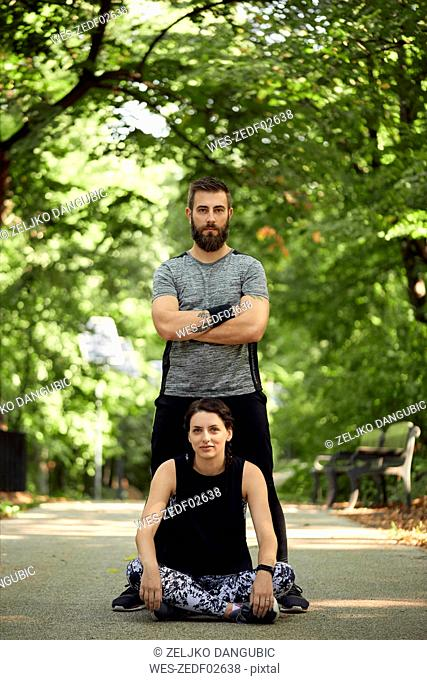 Portrait of sporty couple on forest path
