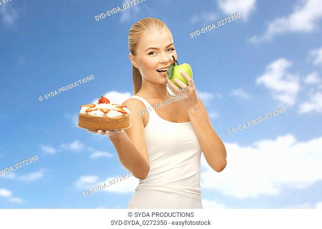 happy woman eating apple instead of cake