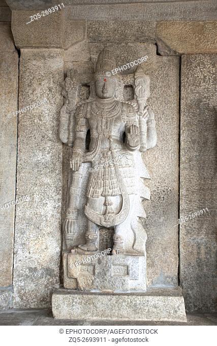 Dvarapala on the left at the entrance gate to the Gomateshwara temple, Vindhyagiri Hill, Shravanbelgola, Karnataka, India