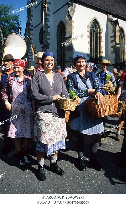 People in parade at public festival Cannstatt Stuttgart Baden-Wurttemberg Germany Cannstatter Wasen
