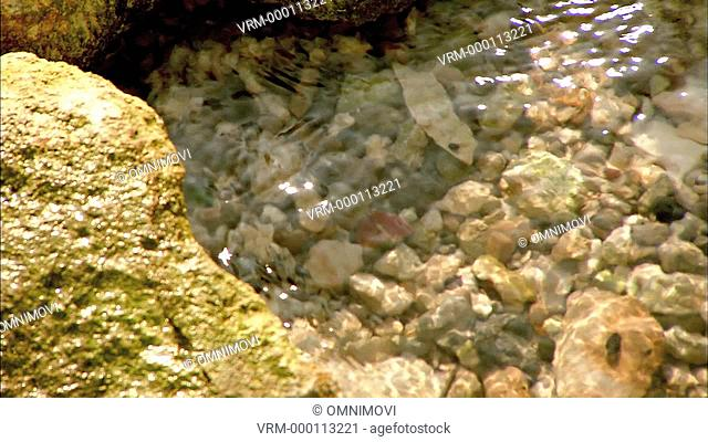 Water moving over pebbles and stones