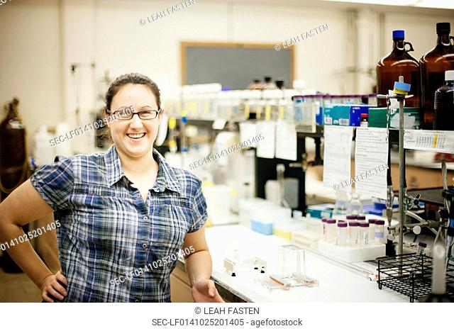 Portrait of smiling mid-adult woman in laboratory