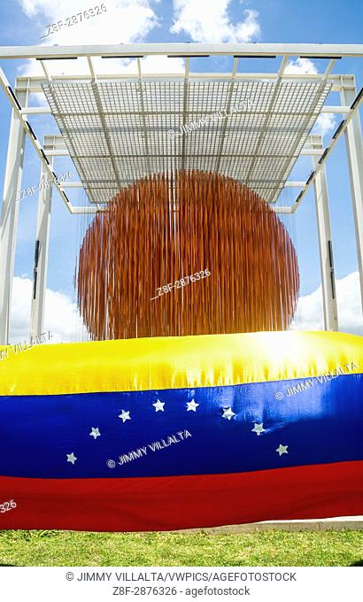Sculpture by artist Jesús Soto and the flag of Venezuela. Venezuelans opposed to the government gathered on Saturday, May 20, 2017