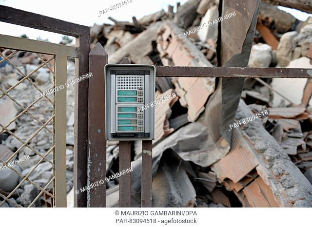 A doorbell panel has remained in its spot in the debris in Amatrice, Italy, 25 August 2016. A strong earthquake claimed numerous lives in central Italy on 24...
