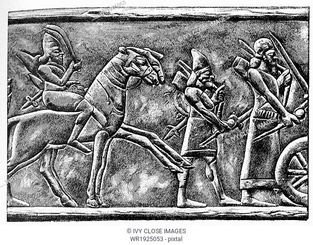 This bas-relief shows an Assyrian horseman armed with a sword. It was drawn by Faucher-Gudin in the early 20th century, from a bas-relief in bronze on the gate...