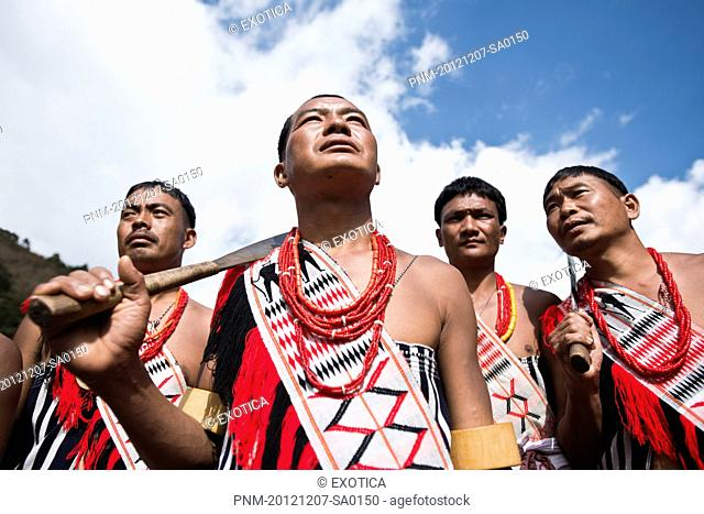 Naga tribesmen in traditional outfit during the annual Hornbill Festival at Kisama, Kohima, Nagaland, India