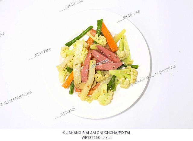 A plate of green and fresh mixed thai saute vegetabls. Top view