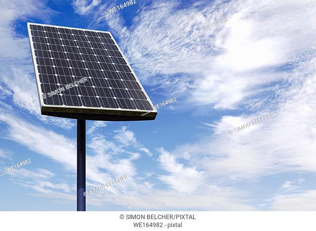 Small Solar Panel Against a Cloudy Blue Sky
