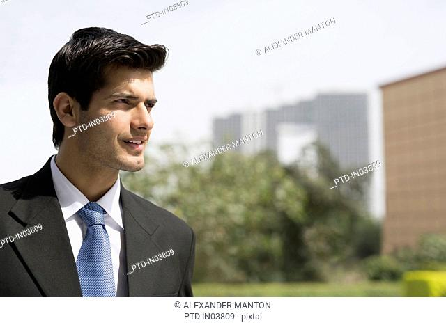 India, Businessman in suit and blue tie