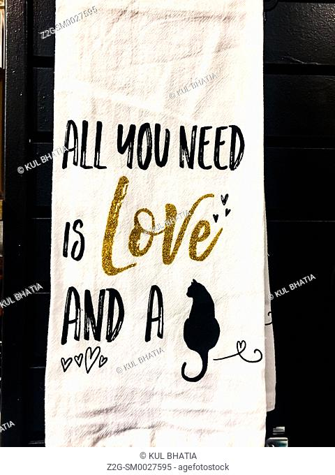 All you need message on a trendy towel — love and a cat