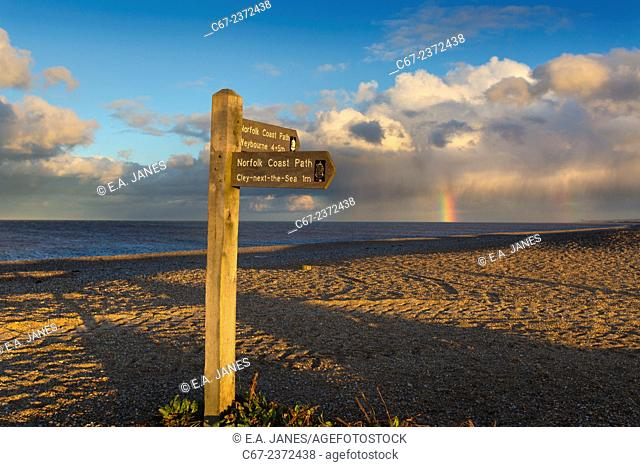 Coastal path on Cley beach Norfolk and coming storm in winter