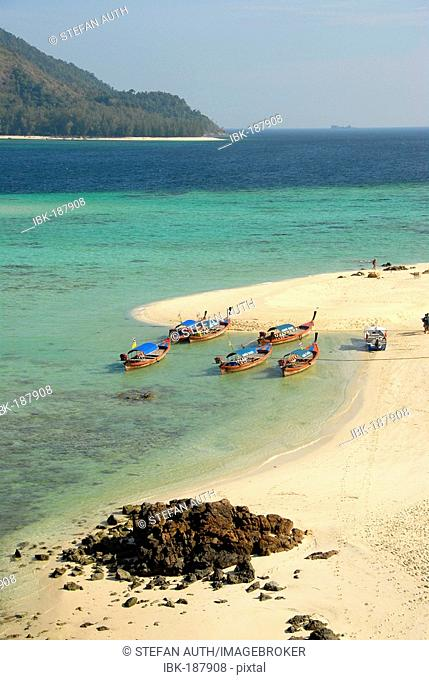 White sandy beach with longtail boats Koh Lipe Thailand