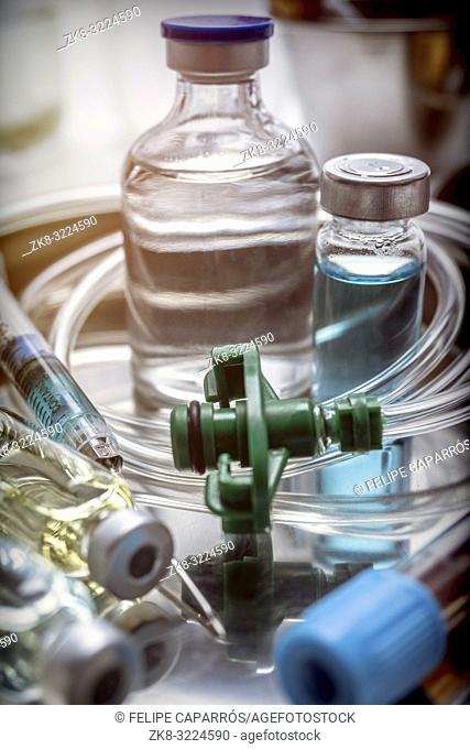 Multiple vial and syringe in a tray metal, conceptual image