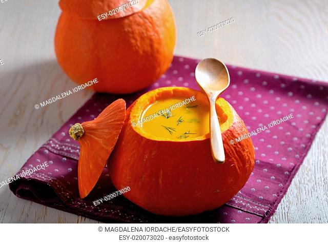 soup with cream in pumpkin