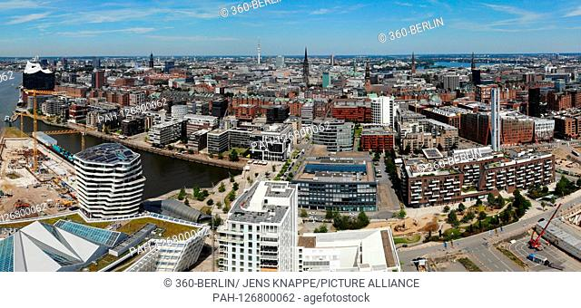 Panorama aerial view: the skyline of Hamburg at new development areas and construction sites in the area of the old Speicherstadt u.a