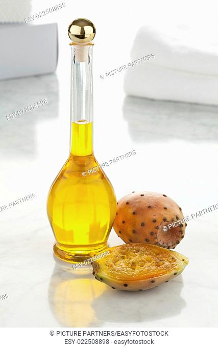 Bottle of prickly pear seed oil and prickly pears