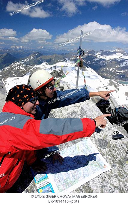 Climbers with map on Stubacher Sonnblick peak, Hohe Tauern National Park, Alps, Austria, Europe