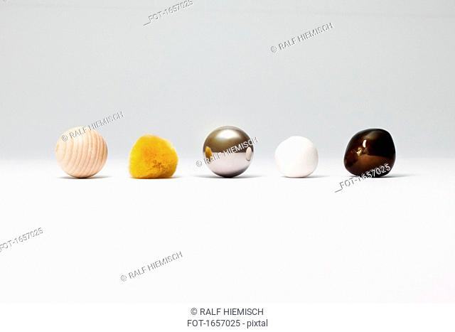 Various spherical objects arranged on white background