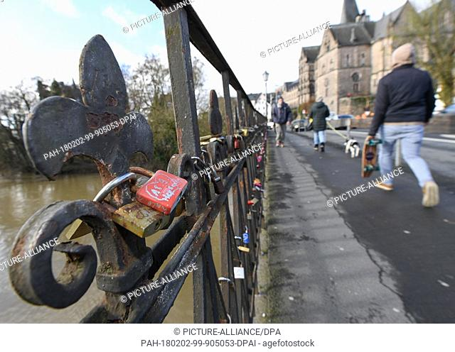 Love locks attached to the Weidenhauser bridge are in danger in Marburg, Germany, 1 February 2018. As the sandstone bridge will soon be renovated