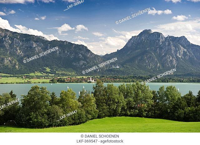 View over lake Forggensee to Schwangau und Neuschwanstein Castle, Schwangau near Fuessen, Allgaeu, Bavaria, Germany