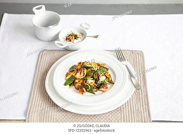 Spicy cubes of pollack with Asian vegetables and peanut dip