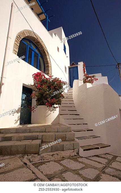 Whitewashed house with blue door in Isternia village, Tinos Island, Cyclades Islands, Greek Islands, Greece, Europe