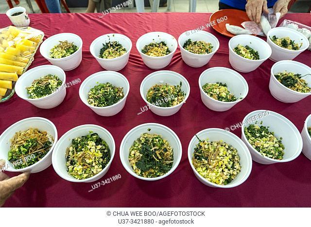 Chinese Hakka 'Lui Cha' mixed vegetables rice served at Sarawak Chai's Clan Association in Kuching, Sarawak, Malaysia