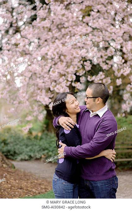 USA, Couple hugging in park