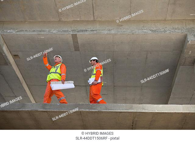 Workers walking at construction site