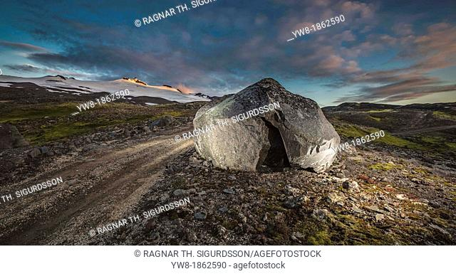 Large rock by gravel road, by Snaefellsjokull glacier  Snaefellsnes Peninsula, Iceland Icelandic folklore tell stories of elves living in such large rocks
