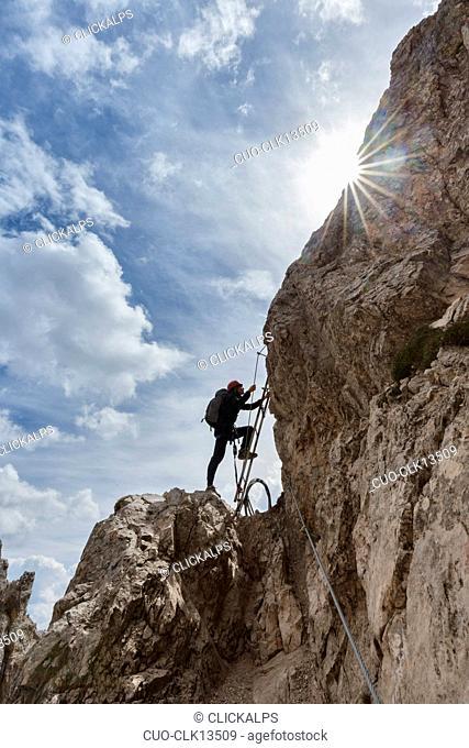 Hiker along the via ferrata of the forks in the Paterno (Paternkofel) mount, Belluno, Sexten Dolomites, Veneto, Italy, Europe