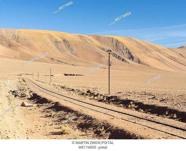 The railway Salta - Antofagasta in the argentinian Altiplano near the salt flat Salar de Arizaro and Tolar Grande . South America, Argentina