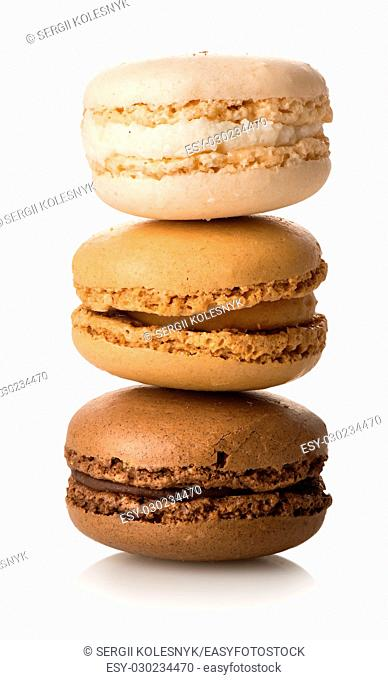 Caramel macarons isolated on a white background