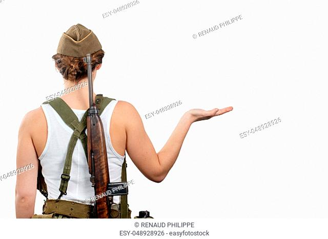 back view young woman dressed in American ww2 military uniform showing empty blank signboard with copy space