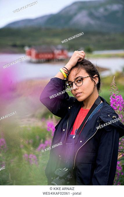 Portrait of a young woman traveling in Norwegian lapland