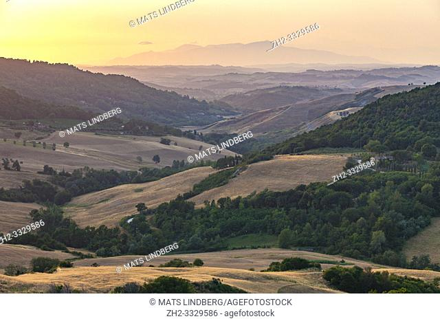 Landscape in Tuscany at sunset with hills and mountains and nice warm evening colors, Tuscany, Italy
