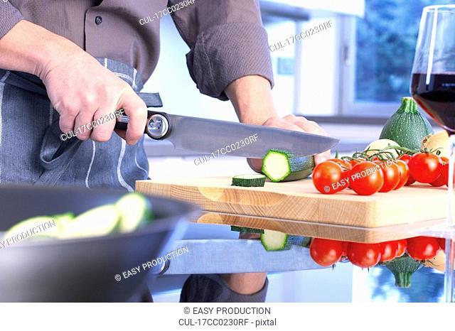 man hands chopping vegetables