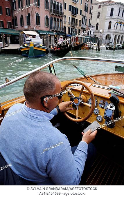 Italy, Venice, in a water taxi (motoscafo) on the canals