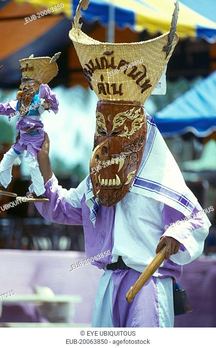 Phi Ta Khon or Spirit Festival. Person wearing spirit costume