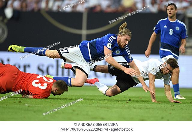 Germany's Leon Goretzka (R) in action against San Marino's Juri Biordi (C) and San Marino's goalkeeper Elia Benedettini (bottom L) during the World Cup...