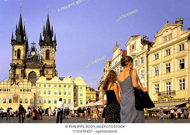 Tourists in the old town square (Staromestske), in the background the gothic Tyn cathedral, Prague, Czech Republic