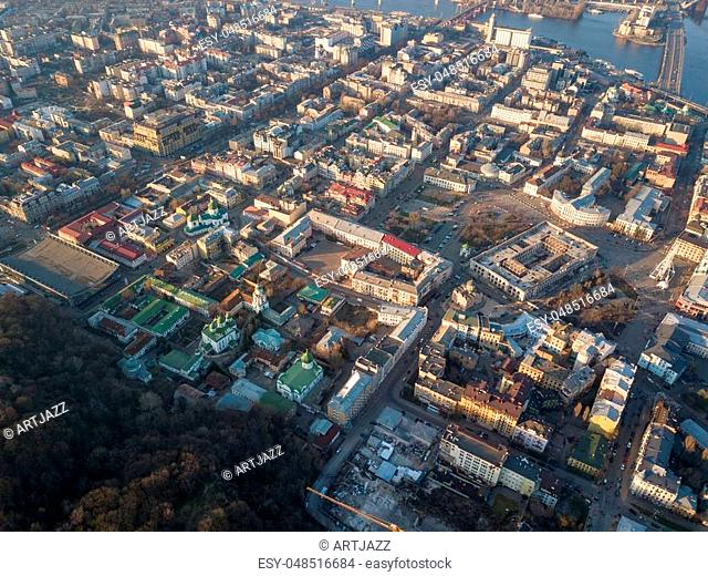 Aerial panoramic view from the drone to the oldest district of Kiev - Podol with the Kontraktova Square, Frolovsky Monastery, Havana bridge and old buildings