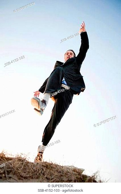 Low angle view of a businessman running