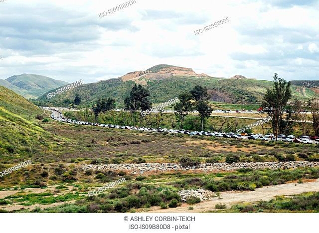 Landscape view with busy parking lot off highway, North Elsinore, California, USA