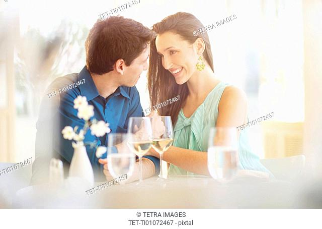 Couple sitting in restaurant