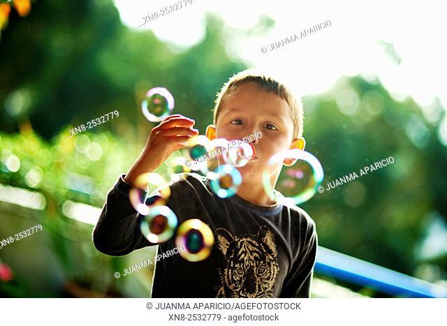 Child making Bubbles