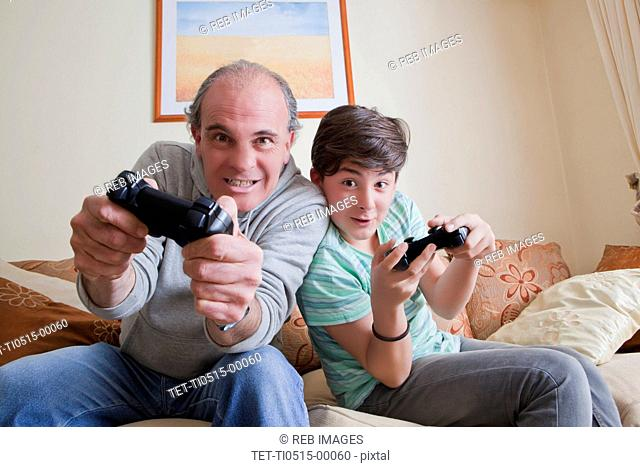 Father and teenage son playing video game
