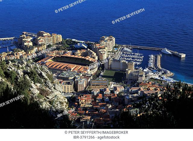 Fontvieille, district built on reclaimed land, with the football stadium and the Port of Cap d'Ail, seen from underneath the Tête du Chien