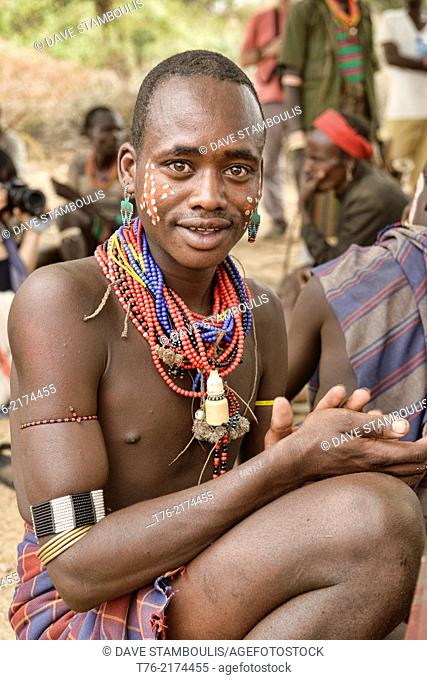 Hamer warrior at a bull jumping ceremony in the Omo Valley, Ethiopia. Jumping a lineup of cattle is a rite of passage into manhood for young Hamer men